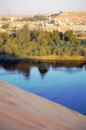 nile source: Overlooking the tourist town of aswan from outskirts sand bank on nile