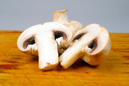 group of mushrooms on wooden chopping board Stock Photo - 6429296
