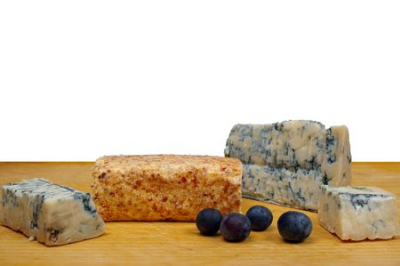 Gorgonzola and apricot cheese on  wooden board with blueberry  photo