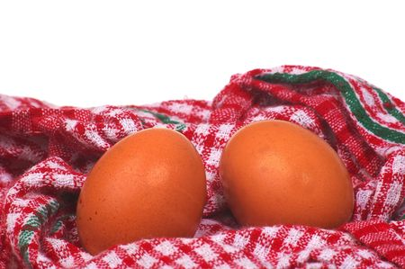 two boiled eggs in table cloth tea towel photo