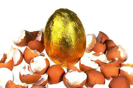 giant easter egg: giant easter egg against broken egg shells Stock Photo