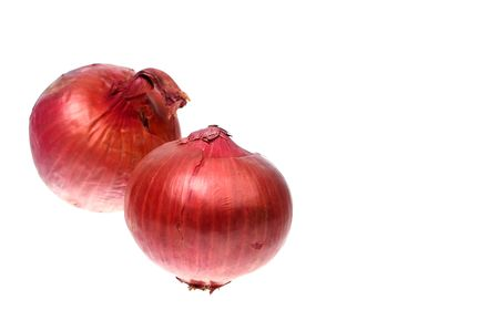 two whole red onions over white isolated photo