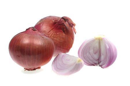 two whole red onions over white isolated with segments photo