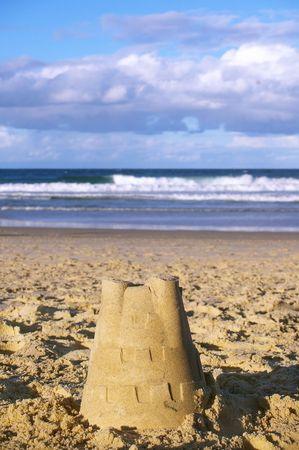 sand castle building on the shore of gold coast australia photo