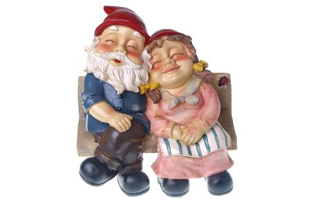 lawn gnome: pair of garden gnomes in love together on chair