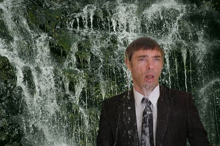 wet suit: business man concept image back to nature  waterfall cleanse