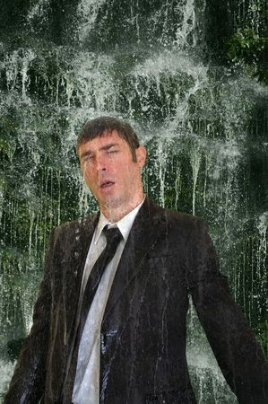 miserable: business man concept image back to nature  waterfall cleanse