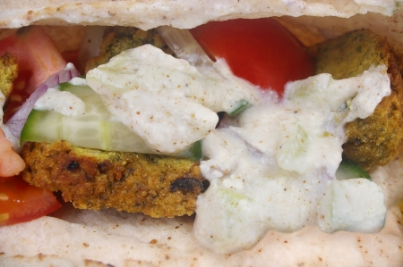 traditional falafel pocket bread sandwich with salad photo