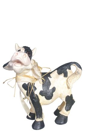 toy plastic cow isolated over white background Stock Photo - 7332833