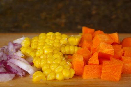 mixed vegetables on chopping  board for chicken pie photo