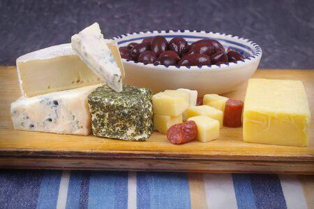 kalamata: cheese antipasto varieties on board with kalamata olives