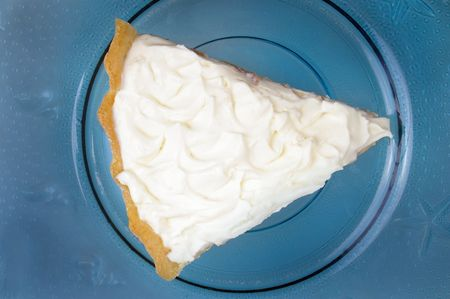 banana cream custard  pie on blue glass plate