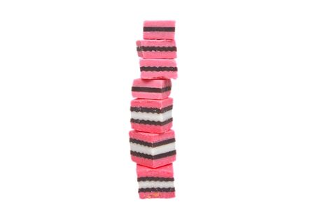 pink and black licorice isolated over white
