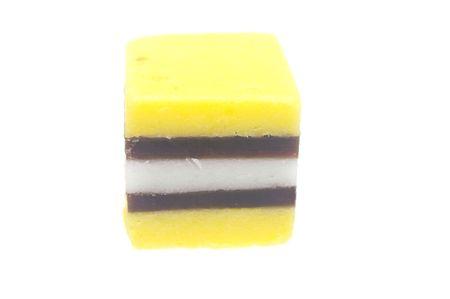 yellow and black plus white licorice over white Stock Photo - 7909600