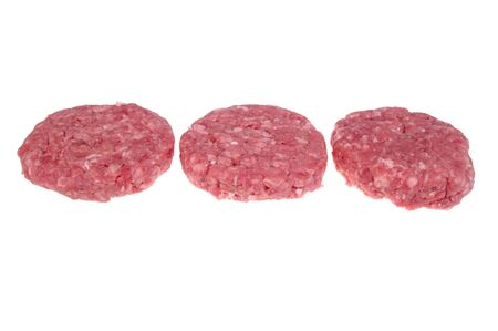 organic minced meat burger patty isolated over white photo