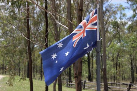 outback: australian flag with gum tree outback background