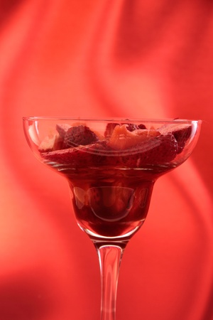 strawberry in cocktail glass with syrup of chocolate or vinegar photo