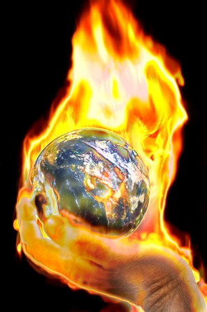 earth on fire in hand concept image