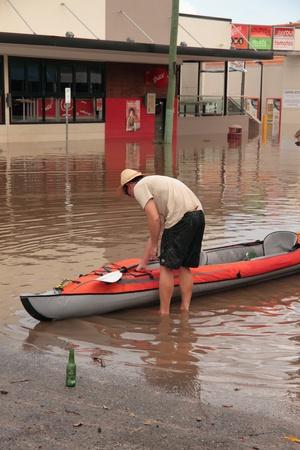 residents: BRISBANE, AUSTRALIA - JAN 13 : Flood  Brisbane auchenflower area residents and tourists take to rafts January 13, 2011 in Brisbane, Australia  Editorial