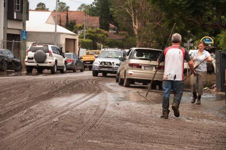 flood area: BRISBANE, AUSTRALIA - JAN 14 : Flood  Brisbane Fairfield area community volunteers clean up January 14, 2011 in Brisbane, Australia