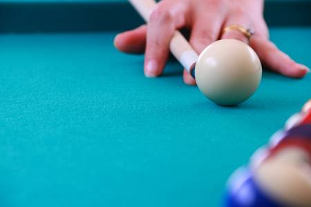 woman breaking billard balls close up image photo