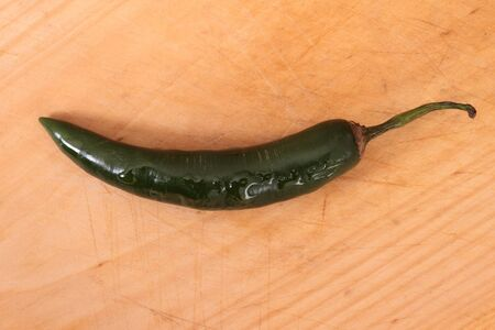 green sweet and hot small chilli on board photo