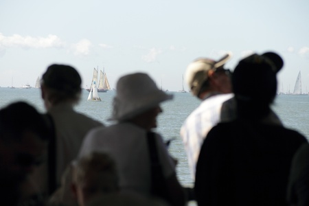 BRISBANE, AUSTRALIA - APR 22 : The Brisbane to Gladstone Yacht Race crowds watching yachts in background  April 22, 2011 in Brisbane, Australia
