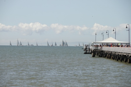 BRISBANE, AUSTRALIA - APR 22 : The Brisbane to Gladstone Yacht Race shows boats ready for start or Sandgate pier  April 22, 2011 in Brisbane, Australia