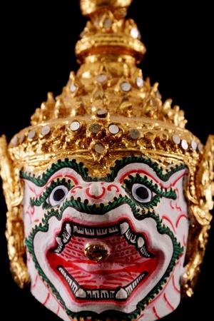 thai traditional Souvenir warrior dance animal mask isolated on black photo