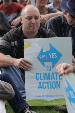 BRISBANE, AUSTRALIA - JUNE 6 : man with say Yes to climate action sign listening to rally speakers during World Enviroment Day say Yes protest 6, 2011 in Brisbane, Australia