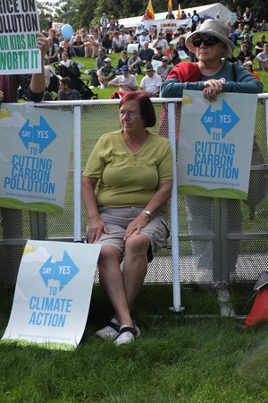 BRISBANE, AUSTRALIA - JUNE 6 : older women with cut pollution and say yes to carbon tax protest signs at during World Enviroment Day rally 6, 2011 in Brisbane, Australia
