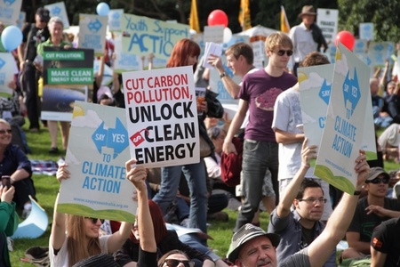enviroment: BRISBANE, AUSTRALIA - JUNE 6 : crowds with say Yes to cutting carbon pollution and clean energy signs at rally during World Enviroment Day say yes protest 6, 2011 in Brisbane, Australia