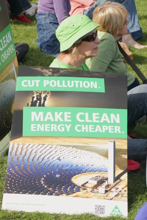 BRISBANE, AUSTRALIA - JUNE 6 : Woman with anti polution clean energy sign at say Yes to carbon tax World Enviroment Day protest 6, 2011 in Brisbane, Australia