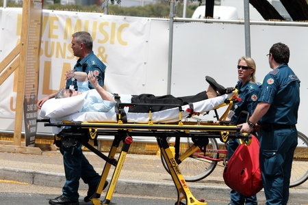 medical attention: BRISBANE, AUSTRALIA  OCT 24 : Woman given medical attention in the heat during the English Royal visit October  24, 2011 in Brisbane, Australia  Editorial