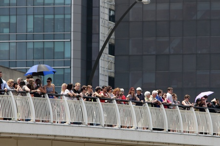 BRISBANE, AUSTRALIA  OCT 24 : Onlookers awaiting the English Royal boat coming down the Brisbane river form the William Jolly Bridge October  24, 2011 in Brisbane, Australia  Stock Photo - 10971055