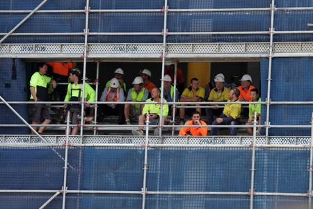 BRISBANE, AUSTRALIA  OCT 24 : Construction workers stop work to view the Queen Elizabeth 11 visit 24, 2011 in Brisbane, Australia