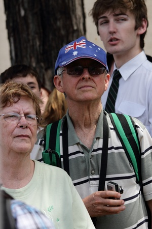 onlooker: BRISBANE, AUSTRALIA  OCT 24 : Onlooker wearing patriotic flag hat waiting to see Queen Elizabeth 11 October 24, 2011 in Brisbane, Australia