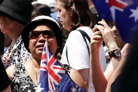 BRISBANE, AUSTRALIA  OCT 24 : indigenous Australian flag waving at Queen Elizabeth 11 veiwing October 24, 2011 in Brisbane, Australia