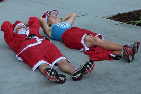 chilling out: BRISBANE, AUSTRALIA  NOV 27 :Unidentified runners chilling out before Variety Santa Fun Run November 27, 2011 in Brisbane, Australia  Editorial