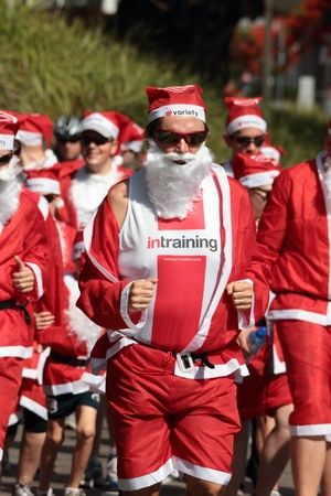 BRISBANE, AUSTRALIA  NOV 27 :Unidentified santa in training outfit during Variety Santa Fun Run November 27, 2011 in Brisbane, Australia