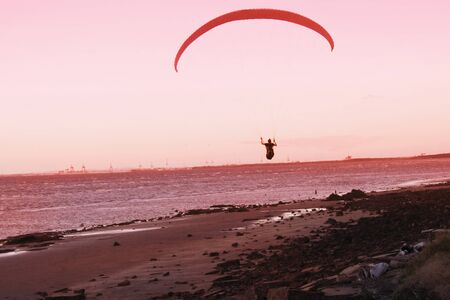 sunset silhouette of paraglider brisbane queensland australia photo