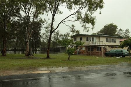 BRISBANE, AUSTRALIA - JAN 25 : One year on Brisbane flooding again, rising flodd water at Rothwell home January 25, 2012 in Brisbane, Australia
