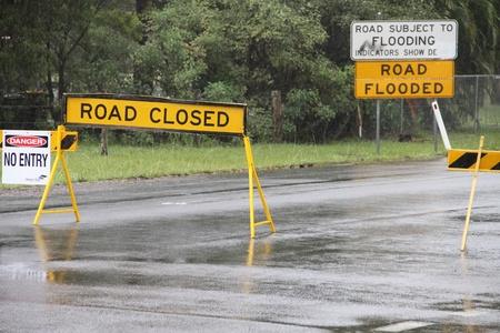 BRISBANE, AUSTRALIA - JAN 25 : One year on Brisbane flooding again, old bay road closed Burpengay January 25, 2012 in Brisbane, Australia  Stock Photo - 12160616