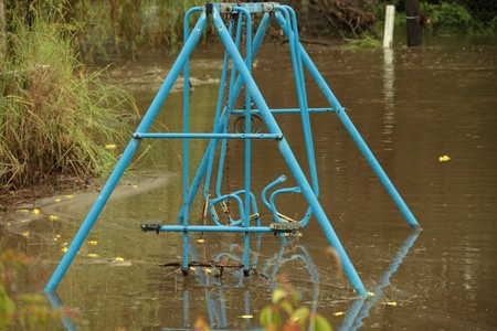BRISBANE, AUSTRALIA - JAN 25 : One year on Brisbane flooding again, flooded childs swing Burpengary January 25, 2012 in Brisbane, Australia