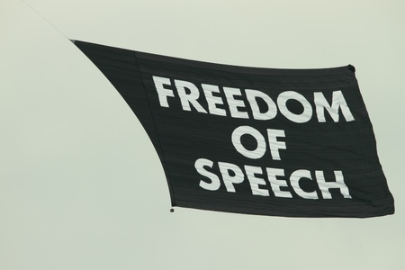 outspoken: A random protest freedom of speech flags flys over brisbane with no other protests