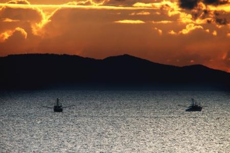fishing trawler brisbane bay orange sunset hdr Stock Photo - 13817430
