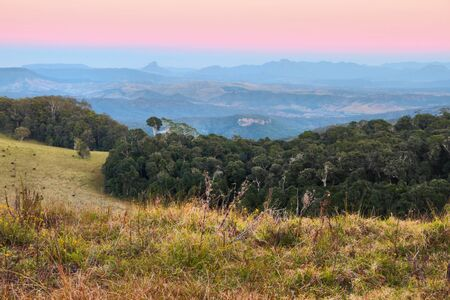views of the border ranges on duck road lamington national park overlooking farmland showing typical australian bush background photo