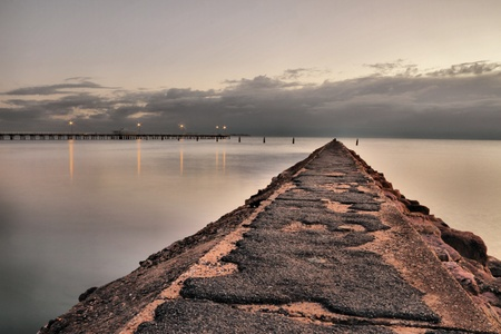 old peir in shorncliffe overlooking newer pier  photo