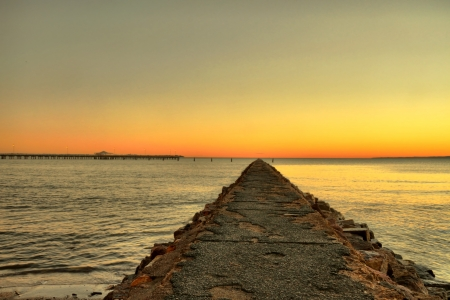 old concrete pier to vanishing point of sunset photo