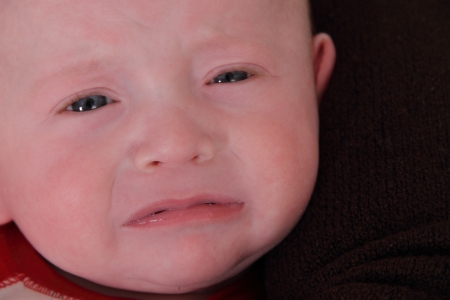baby twin boy with a large 97th percentile expressive face Banco de Imagens